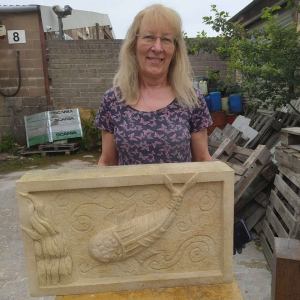 Ann-ith-her-relief-carving-in-Bath-stone