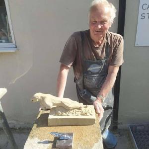 Chris-has-carved-a-Jaguar-emblem-in-Bath-stone