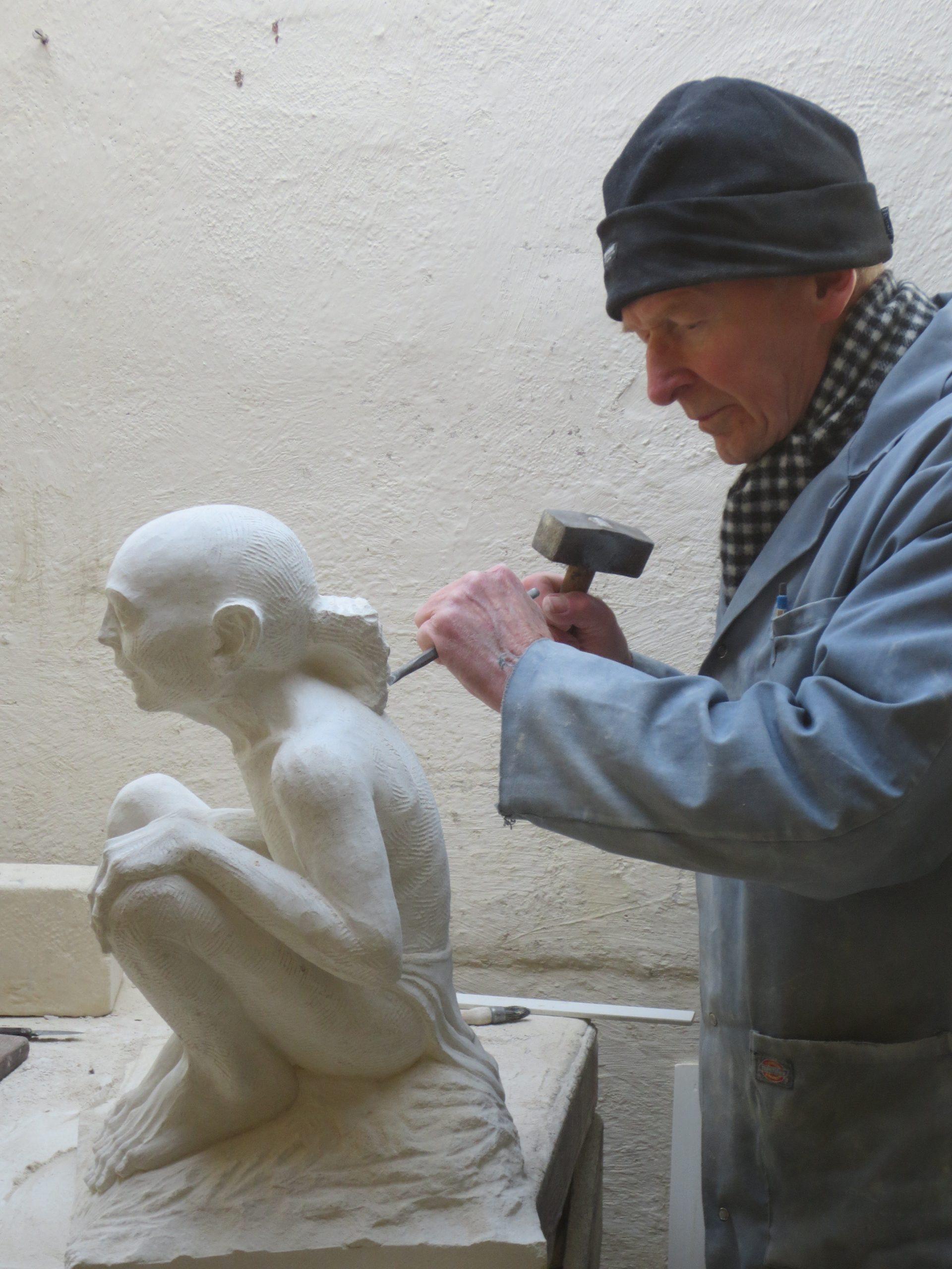 Carving a fine piece of Portland stone